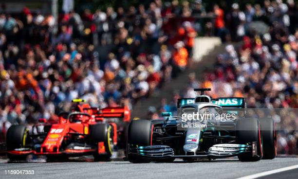 Lewis Hamilton of Great Britain driving the Mercedes AMG Petronas F1 Team Mercedes W10 leads Charles Leclerc of Monaco driving the Scuderia Ferrari...