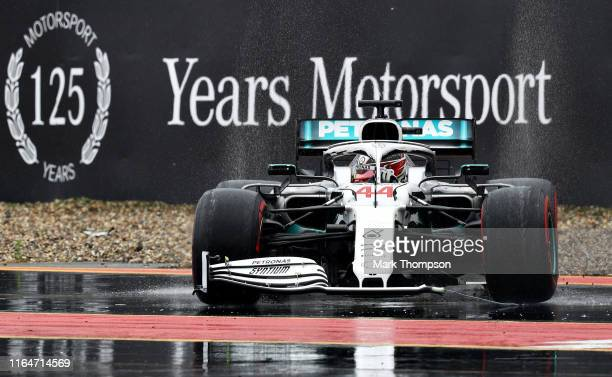 Lewis Hamilton of Great Britain driving the Mercedes AMG Petronas F1 Team Mercedes W10 with a broken front wing after crashing during the F1 Grand...
