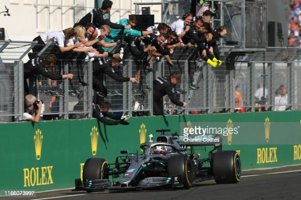 Lewis Hamilton of Great Britain driving the Mercedes AMG Petronas F1 Team Mercedes W10 takes the chequered flag and the win during the F1 Grand Prix...