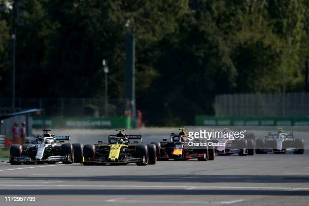 Lewis Hamilton of Great Britain driving the Mercedes AMG Petronas F1 Team Mercedes W10 and Nico Hulkenberg of Germany driving the Renault Sport...