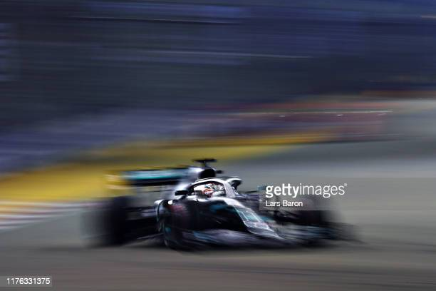 Lewis Hamilton of Great Britain driving the Mercedes AMG Petronas F1 Team Mercedes W10 on track during the F1 Grand Prix of Singapore at Marina Bay...