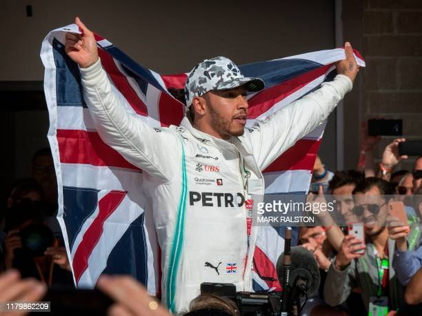 Lewis Hamilton of Great Britain driving the Mercedes AMG Petronas F1 Team reacts after being crowned World Champion during his second place finish at...