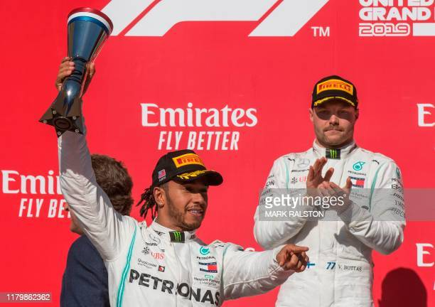 Lewis Hamilton of Great Britain driving the Mercedes AMG Petronas F1 Team reacts after being crowned World Champion during his second place finish,...