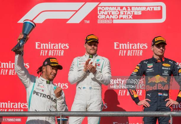 Lewis Hamilton of Great Britain driving the Mercedes AMG Petronas F1 Team reacts after being crowned World Champion during his second place finish...