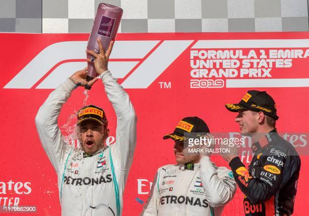 Lewis Hamilton of Great Britain driving the Mercedes AMG Petronas F1 Team celebrates after being crowned World Champion during his second place...