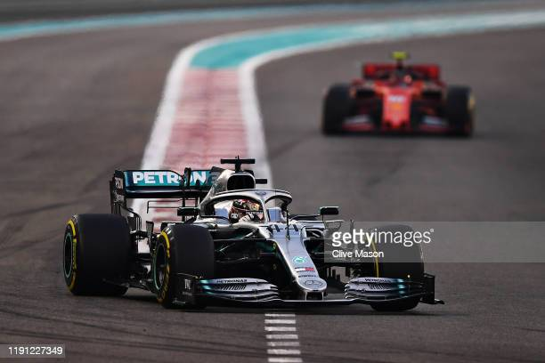 Lewis Hamilton of Great Britain driving the Mercedes AMG Petronas F1 Team Mercedes W10 leads Charles Leclerc of Monaco driving the Scuderia Ferrari...