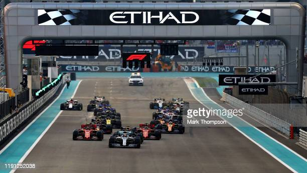 Lewis Hamilton of Great Britain driving the Mercedes AMG Petronas F1 Team Mercedes W10 leads the field at the start during the F1 Grand Prix of Abu...