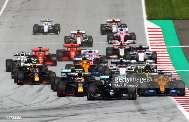 Lewis Hamilton of Great Britain driving the Mercedes AMG Petronas F1 Team Mercedes W11 leads the field at the start of the race into the first corner...