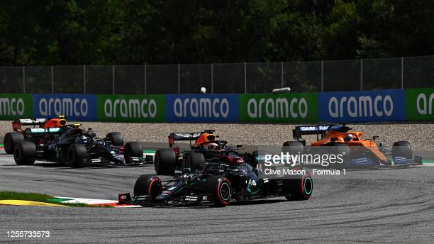Lewis Hamilton of Great Britain driving the Mercedes AMG Petronas F1 Team Mercedes W11 leads the field round turn three at the start during the...