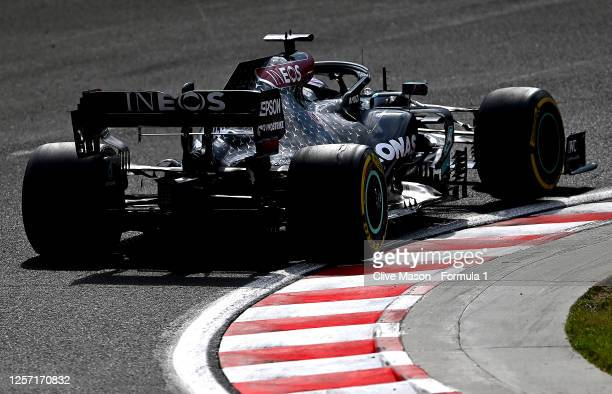 Lewis Hamilton of Great Britain driving the Mercedes AMG Petronas F1 Team Mercedes W11 drives during the Formula One Grand Prix of Hungary at...