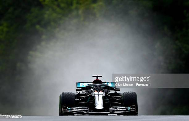 Lewis Hamilton of Great Britain driving the Mercedes AMG Petronas F1 Team Mercedes W11 drives on the way to the grid before the Formula One Grand...