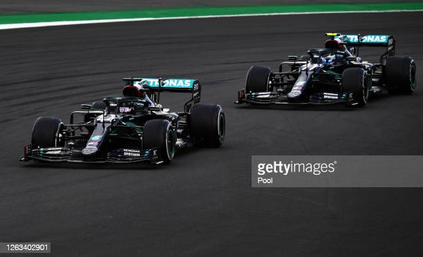 Lewis Hamilton of Great Britain driving the Mercedes AMG Petronas F1 Team Mercedes W11 leads Valtteri Bottas of Finland driving the Mercedes AMG...