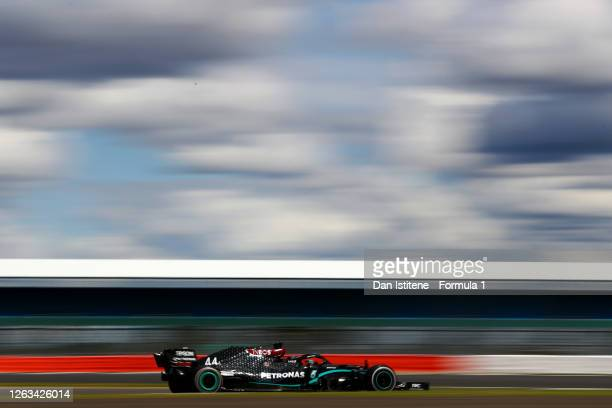 Lewis Hamilton of Great Britain driving the Mercedes AMG Petronas F1 Team Mercedes W11 during the Formula One British Grand Prix at Silverstone on...