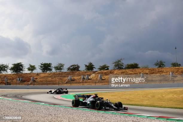 Lewis Hamilton of Great Britain driving the Mercedes AMG Petronas F1 Team Mercedes W11 leads Kevin Magnussen of Denmark driving the Haas F1 Team...