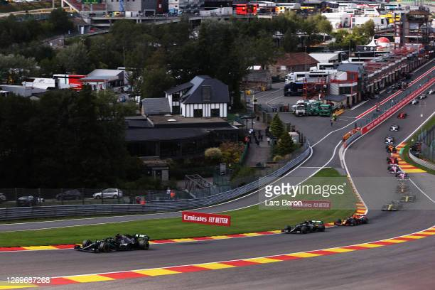 Lewis Hamilton of Great Britain driving the Mercedes AMG Petronas F1 Team Mercedes W11 leads the field at the start of the race during the F1 Grand...
