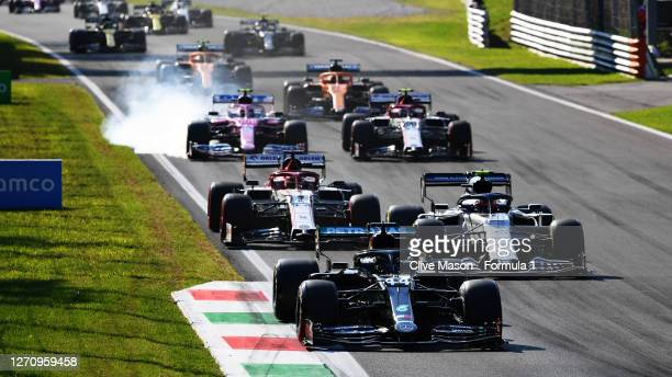 Lewis Hamilton of Great Britain driving the Mercedes AMG Petronas F1 Team Mercedes W11 leads Pierre Gasly of France driving the Scuderia AlphaTauri...