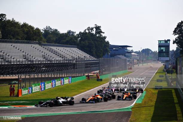 Lewis Hamilton of Great Britain driving the Mercedes AMG Petronas F1 Team Mercedes W11 leads the field into turn one at the start during the F1 Grand...