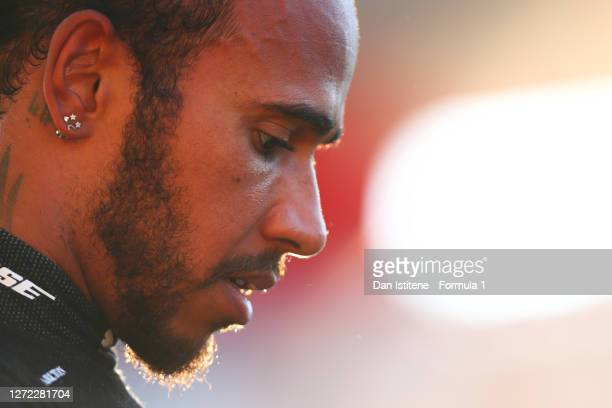 Lewis Hamilton of Great Britain driving the Mercedes AMG Petronas F1 Team Mercedes W11 looks on in parc ferme after winning the F1 Grand Prix of...