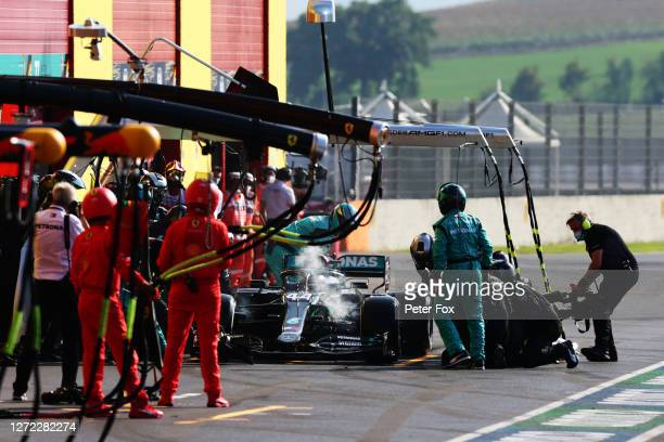 Lewis Hamilton of Great Britain driving the Mercedes AMG Petronas F1 Team Mercedes W11 makes a pitstop during the F1 Grand Prix of Tuscany at Mugello...