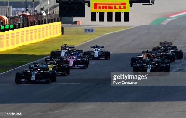 Lewis Hamilton of Great Britain driving the Mercedes AMG Petronas F1 Team Mercedes W11 leads the field as cars restart from the grid following a red...