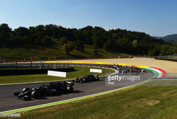 Lewis Hamilton of Great Britain driving the Mercedes AMG Petronas F1 Team Mercedes W11 leads a line of cars during the F1 Grand Prix of Tuscany at...