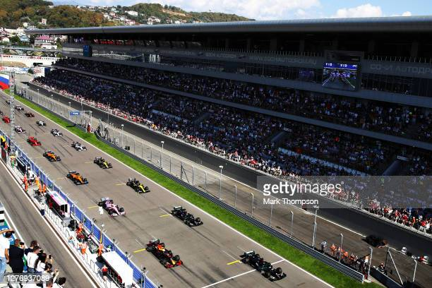 Lewis Hamilton of Great Britain driving the Mercedes AMG Petronas F1 Team Mercedes W11 leads Max Verstappen of the Netherlands driving the Aston...