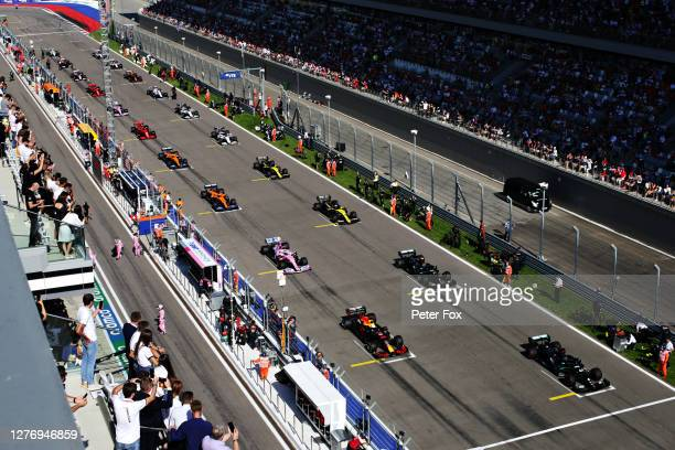 Lewis Hamilton of Great Britain driving the Mercedes AMG Petronas F1 Team Mercedes W11, Max Verstappen of the Netherlands driving the Aston Martin...