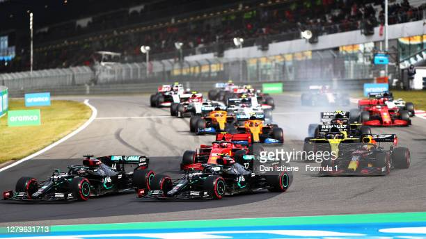 Lewis Hamilton of Great Britain driving the Mercedes AMG Petronas F1 Team Mercedes W11 and Valtteri Bottas of Finland driving the Mercedes AMG...