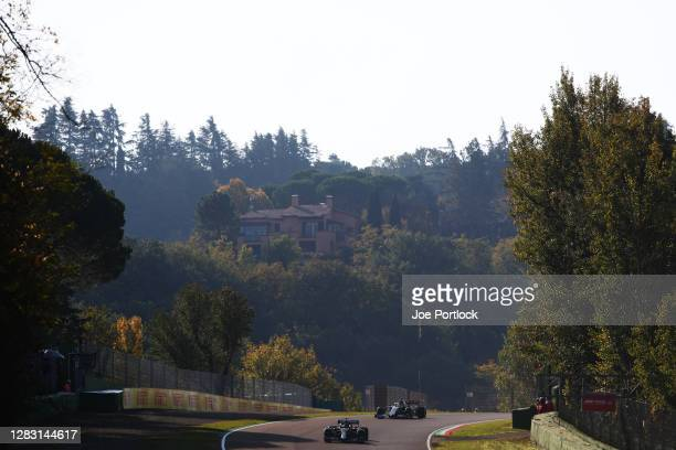 Lewis Hamilton of Great Britain driving the Mercedes AMG Petronas F1 Team Mercedes W11 leads Romain Grosjean of France driving the Haas F1 Team VF-20...