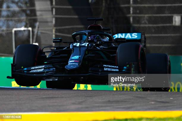 Lewis Hamilton of Great Britain driving the Mercedes AMG Petronas F1 Team Mercedes W11 runs wide and lifts a wheel off the track during qualifying...
