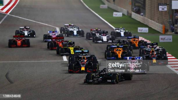 Lewis Hamilton of Great Britain driving the Mercedes AMG Petronas F1 Team Mercedes W11 leads the field into turn one at the restart during the F1...