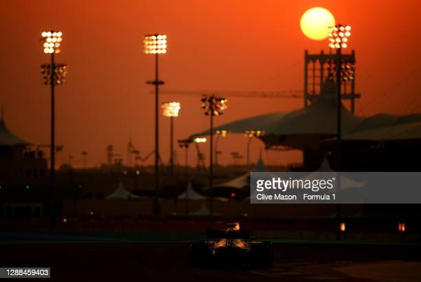 Lewis Hamilton of Great Britain driving the Mercedes AMG Petronas F1 Team Mercedes W11 on his way to the grid before the F1 Grand Prix of Bahrain at...