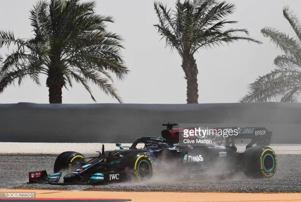 Lewis Hamilton of Great Britain driving the Mercedes AMG Petronas F1 Team Mercedes W12 tries to get out of the gravel trap after spinning during Day...