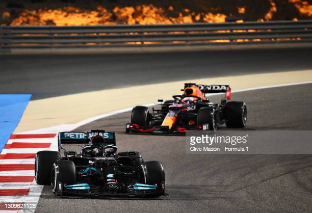 Lewis Hamilton of Great Britain driving the Mercedes AMG Petronas F1 Team Mercedes W12 leads Max Verstappen of the Netherlands driving the Red Bull...