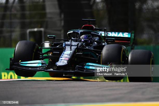 Lewis Hamilton of Great Britain driving the Mercedes AMG Petronas F1 Team Mercedes W12 launches off a raised kerb during practice ahead of the F1...