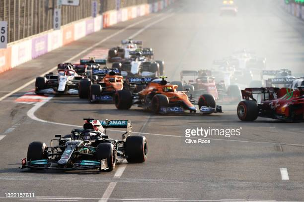 Lewis Hamilton of Great Britain driving the Mercedes AMG Petronas F1 Team Mercedes W12 runs wide after locking up at the restart following a red flag...