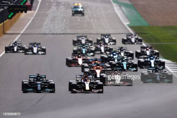 Lewis Hamilton of Great Britain driving the Mercedes AMG Petronas F1 Team Mercedes W12 and Max Verstappen of the Netherlands driving the Red Bull...