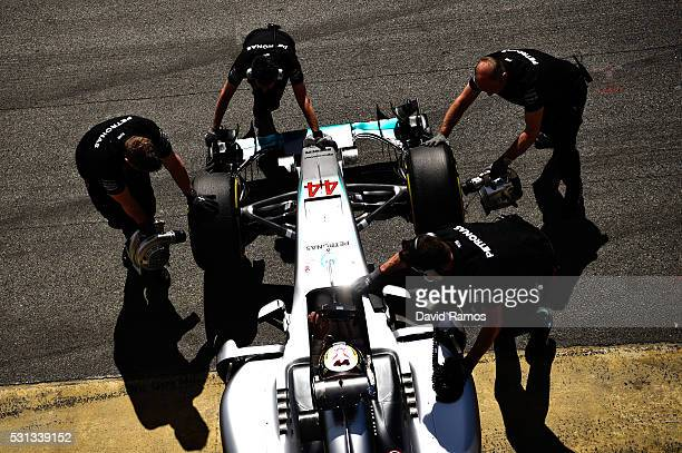 Lewis Hamilton of Great Britain driving the Mercedes AMG Petronas F1 Team Mercedes F1 WO7 Mercedes PU106C Hybrid turbo gets pushed back into the...