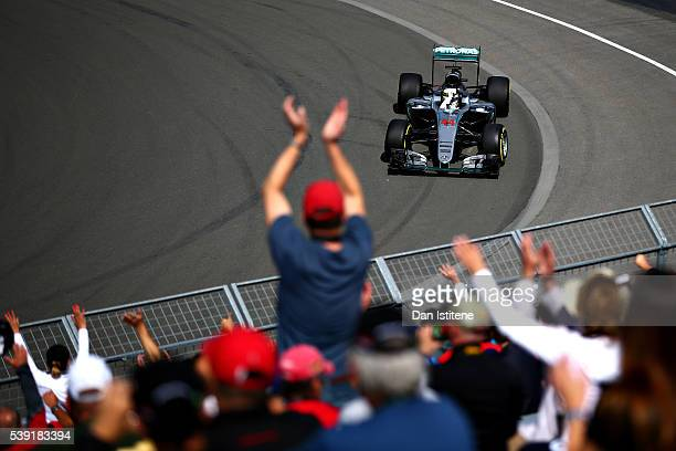 Lewis Hamilton of Great Britain driving the Mercedes AMG Petronas F1 Team Mercedes F1 WO7 Mercedes PU106C Hybrid turbo waves at the crowd on track...