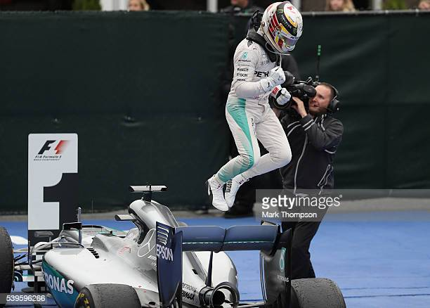 Lewis Hamilton of Great Britain driving the Mercedes AMG Petronas F1 Team Mercedes F1 WO7 Mercedes PU106C Hybrid turbo jumps off his car after...