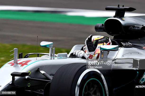 Lewis Hamilton of Great Britain driving the Mercedes AMG Petronas F1 Team Mercedes F1 WO7 Mercedes PU106C Hybrid turbo on track waves to the crowd...