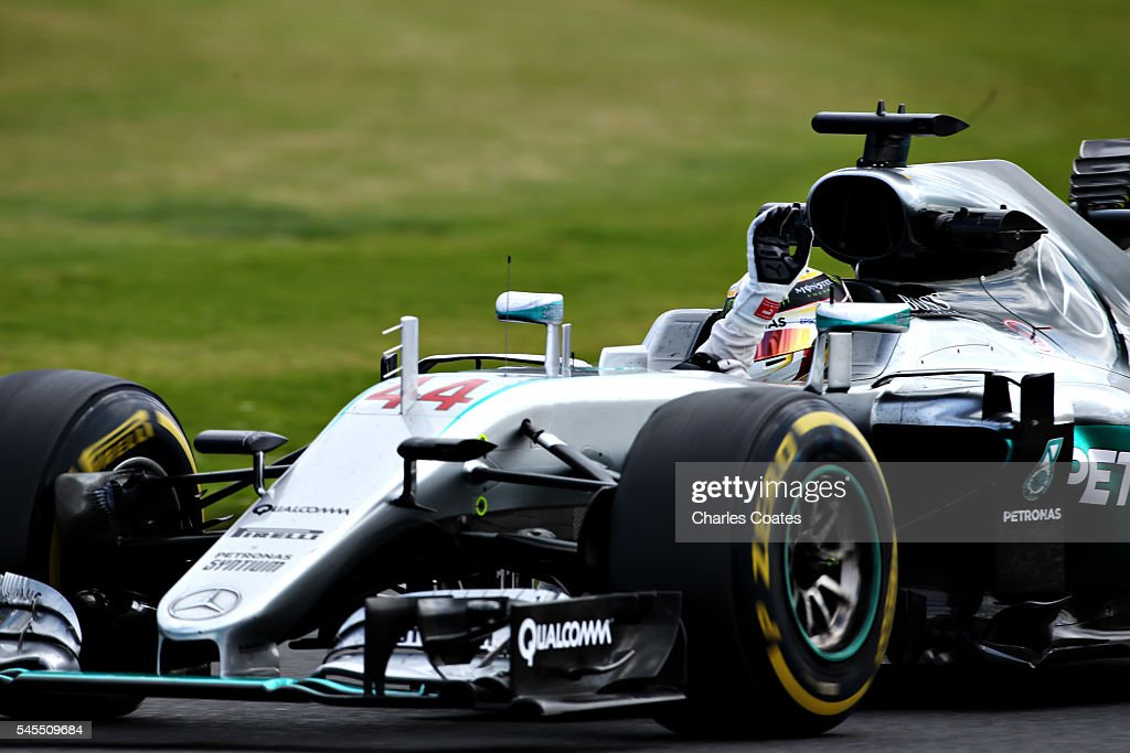 Lewis Hamilton of Great Britain driving the (44) Mercedes AMG Petronas F1 Team Mercedes F1 WO7 Mercedes PU106C Hybrid turbo on track waves to the crowd during practice for the Formula One Grand Prix of Great Britain at Silverstone on July 8, 2016 in Northampton, England.