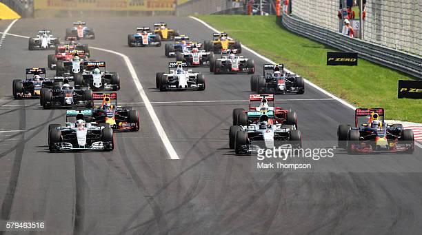 Lewis Hamilton of Great Britain driving the Mercedes AMG Petronas F1 Team Mercedes F1 WO7 Mercedes PU106C Hybrid turbo Nico Rosberg of Germany...