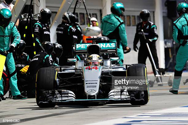 Lewis Hamilton of Great Britain driving the Mercedes AMG Petronas F1 Team Mercedes F1 WO7 Mercedes PU106C Hybrid turbo makes a pit stop during the...