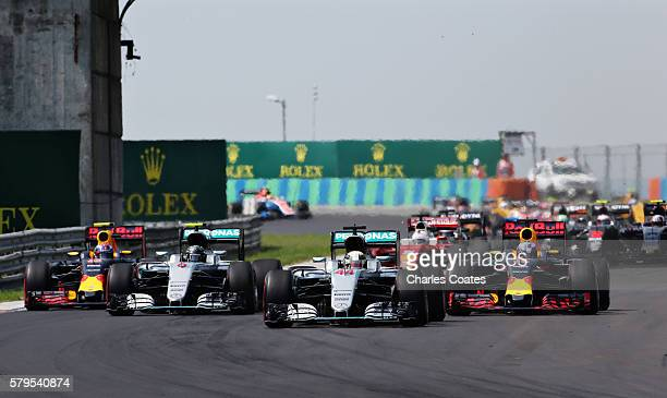 Lewis Hamilton of Great Britain driving the Mercedes AMG Petronas F1 Team Mercedes F1 WO7 Mercedes PU106C Hybrid turbo Nico Rosberg of Germany...