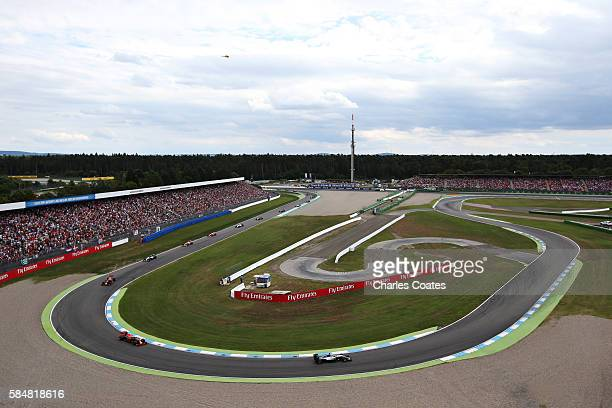 Lewis Hamilton of Great Britain driving the Mercedes AMG Petronas F1 Team Mercedes F1 WO7 Mercedes PU106C Hybrid turbo leads at the start during the...