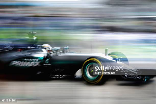 Lewis Hamilton of Great Britain driving the Mercedes AMG Petronas F1 Team Mercedes F1 WO7 Mercedes PU106C Hybrid turbo leaves his garage during final...
