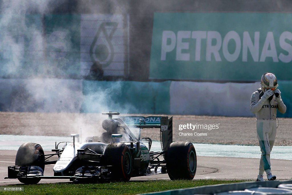 Lewis Hamilton of Great Britain driving the (44) Mercedes AMG Petronas F1 Team Mercedes F1 WO7 Mercedes PU106C Hybrid turbo retires from the grand prix during the Malaysia Formula One Grand Prix at Sepang Circuit on October 2, 2016 in Kuala Lumpur, Malaysia.