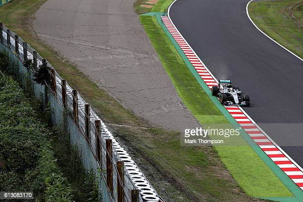 Lewis Hamilton of Great Britain driving the Mercedes AMG Petronas F1 Team Mercedes F1 WO7 Mercedes PU106C Hybrid turbo kicks up some dirt from the...