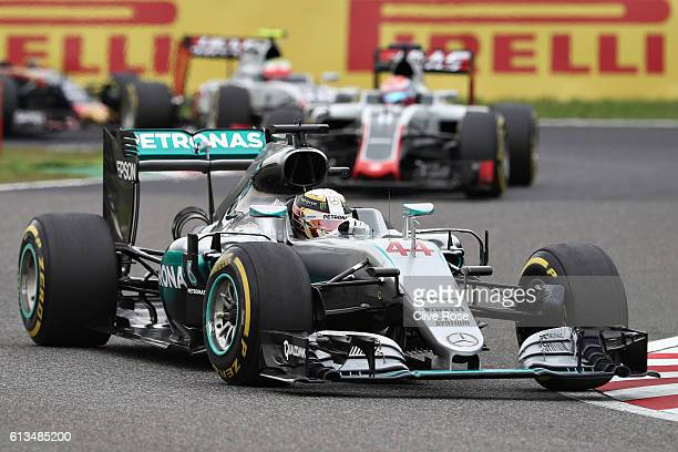 Lewis Hamilton of Great Britain driving the Mercedes AMG Petronas F1 Team Mercedes F1 WO7 Mercedes PU106C Hybrid turbo leads Romain Grosjean of...